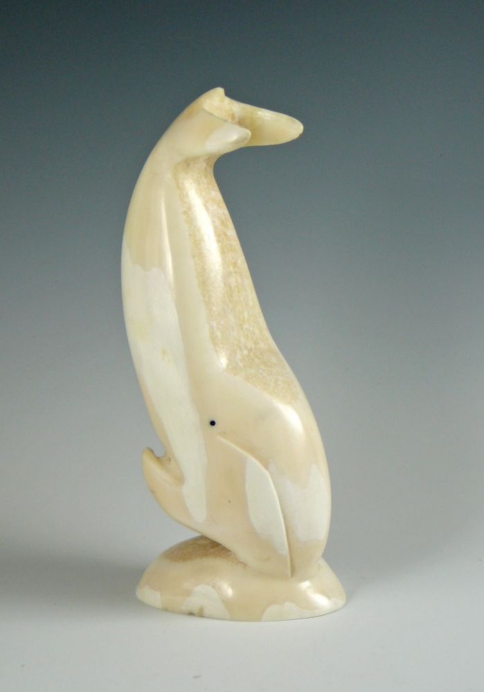 Whale with spirit face relief carving utuqsiq